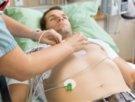 Fastening a Holter monitor onto a patient.
